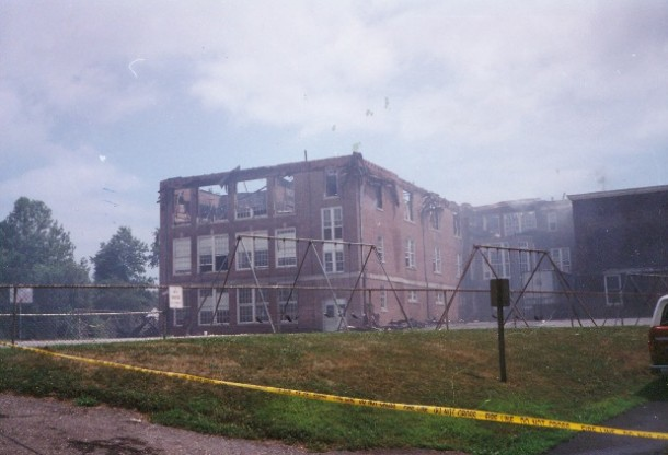 Color photo of burned out school building