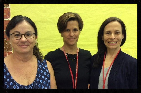 Three teachers smiling.