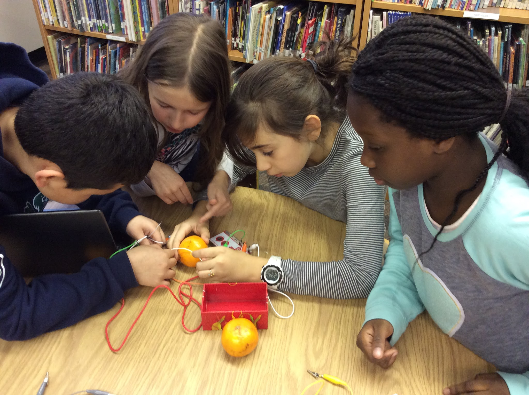 Students working on building circuits with Makey Makey system.