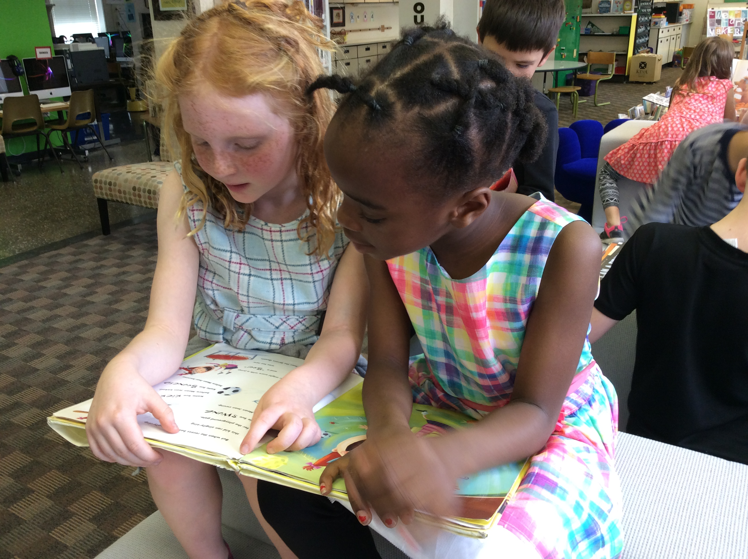 Photo of children reading together.