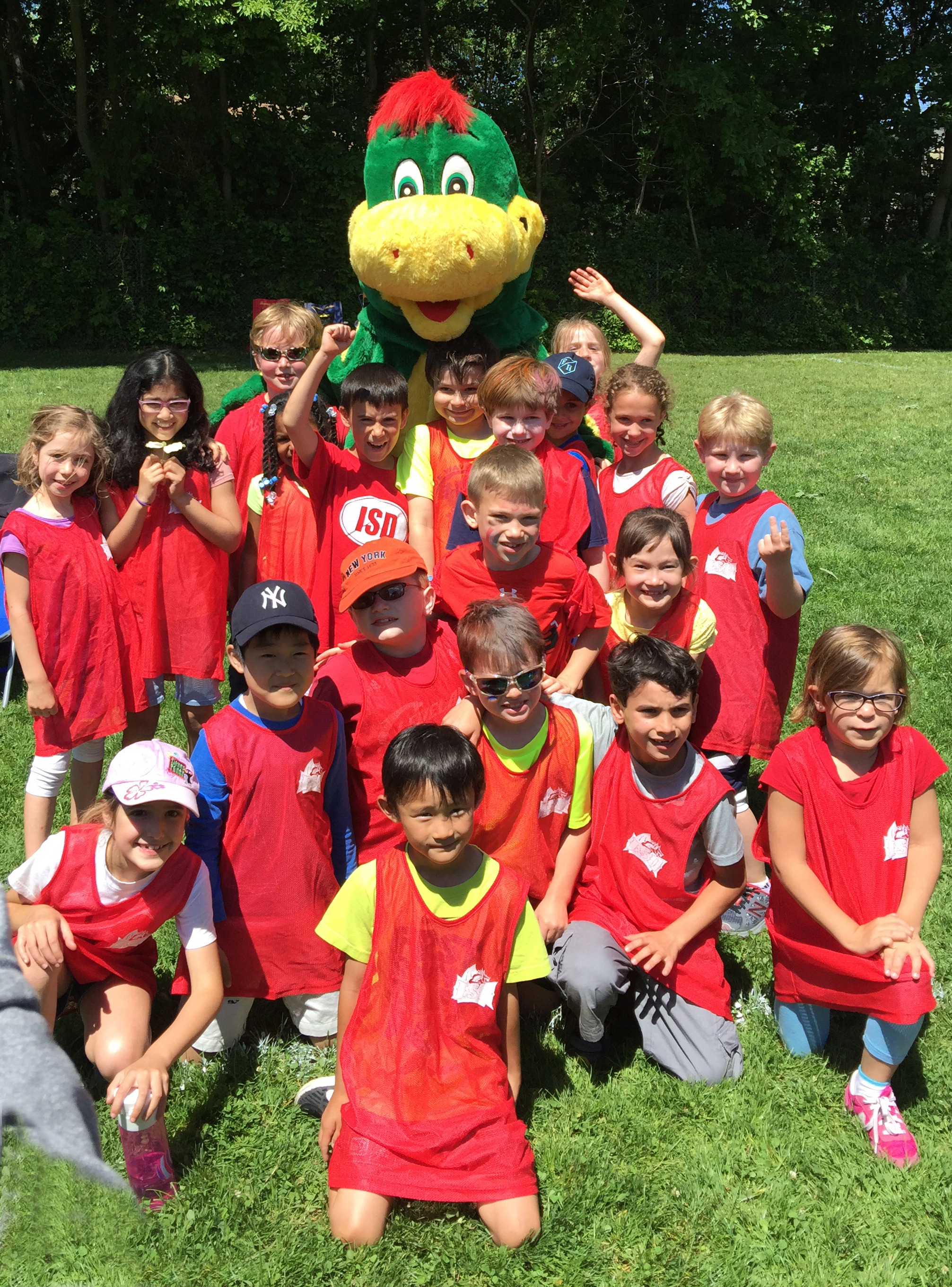 ISD students at Field Day with Sparky the Dragon