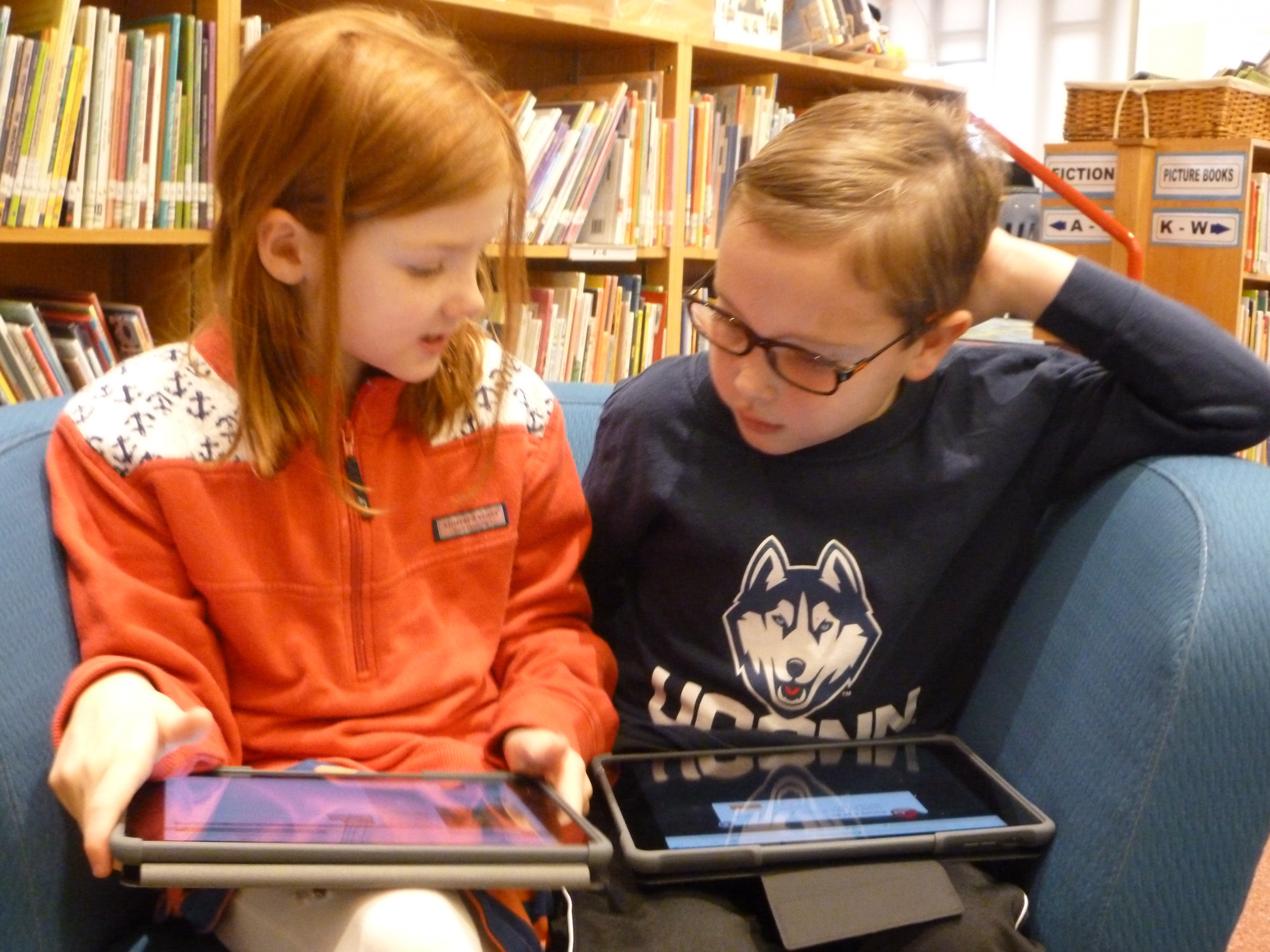 Students with iPads Conferring