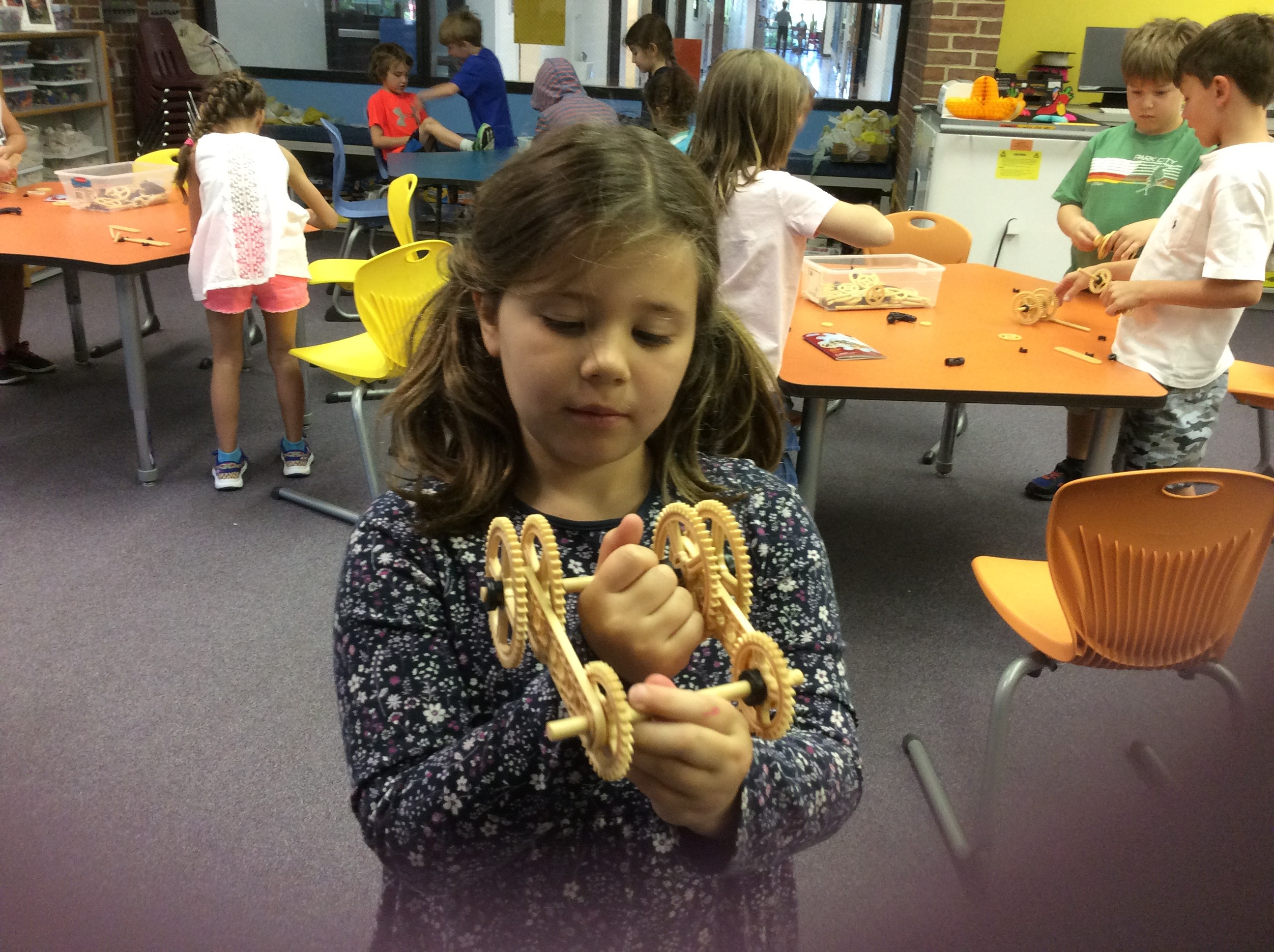 photo of children building with Maker Studio gears
