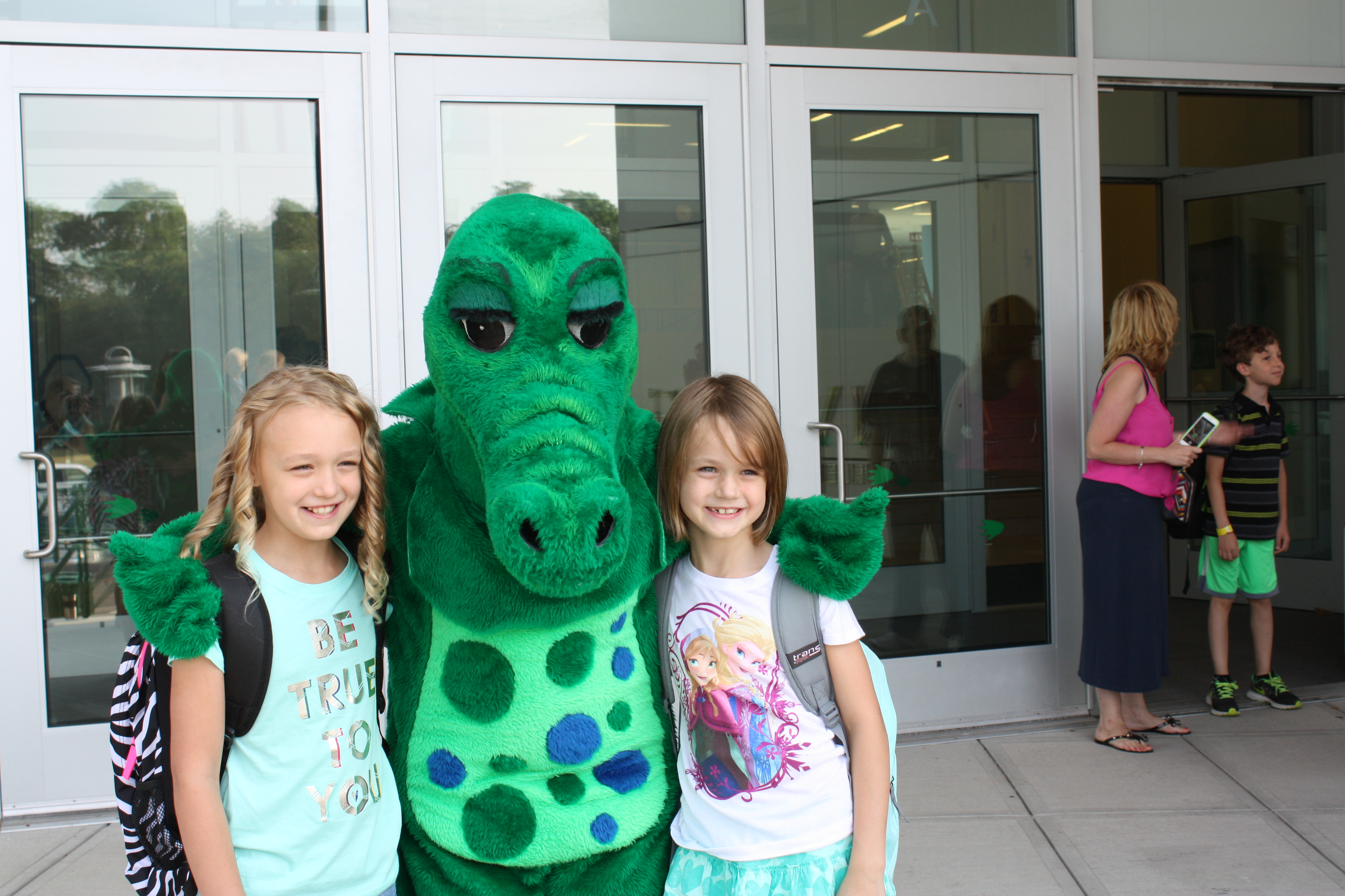 Snappy, the school mascot, with students