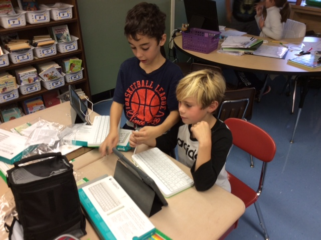 photo of two students working on ipads